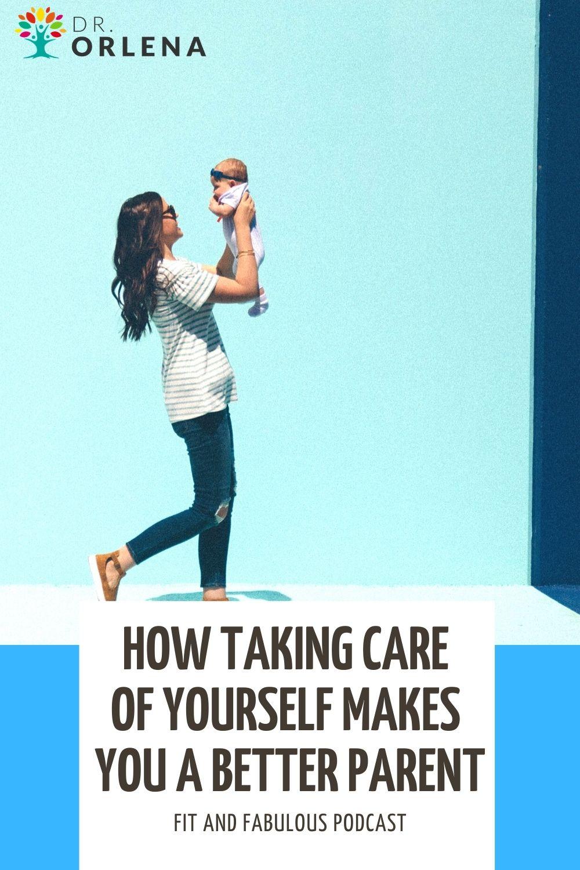 A woman holding up her infant daughter #motherhood #parenting #health #wellness