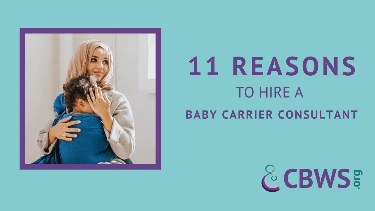 11 Reasons to Hire a Baby Carrier Consultant image of a woman with a head scarf holding a toddler in a ring sling and looking at something off-camera