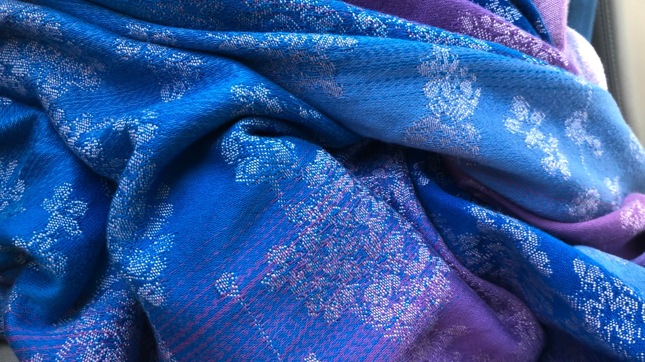 Closeup of a purple and blue baby wrap