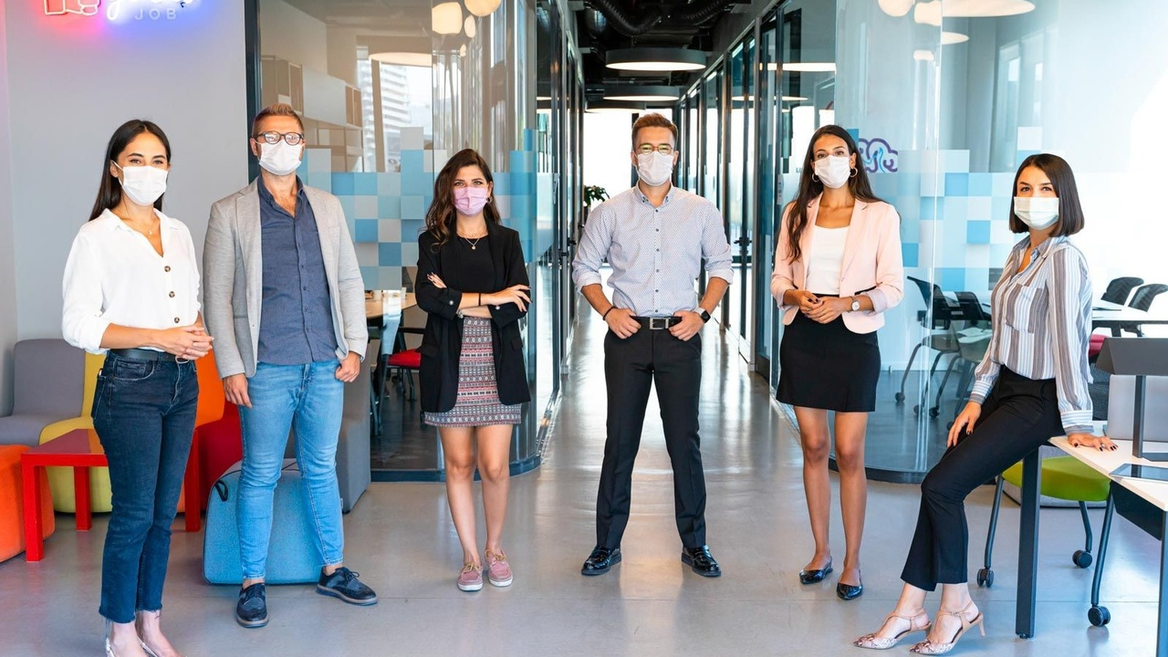 Professional colleagues stood in masks
