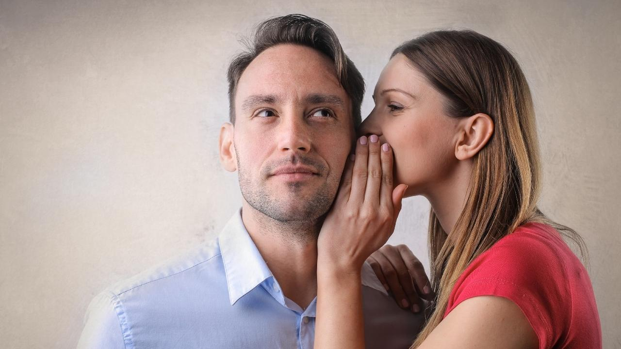 Woman whispers recommendations in mans ear