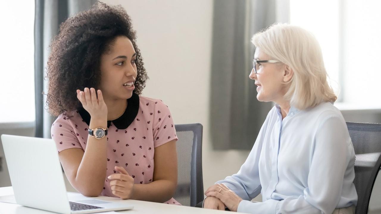 Two women in a feedback meeting