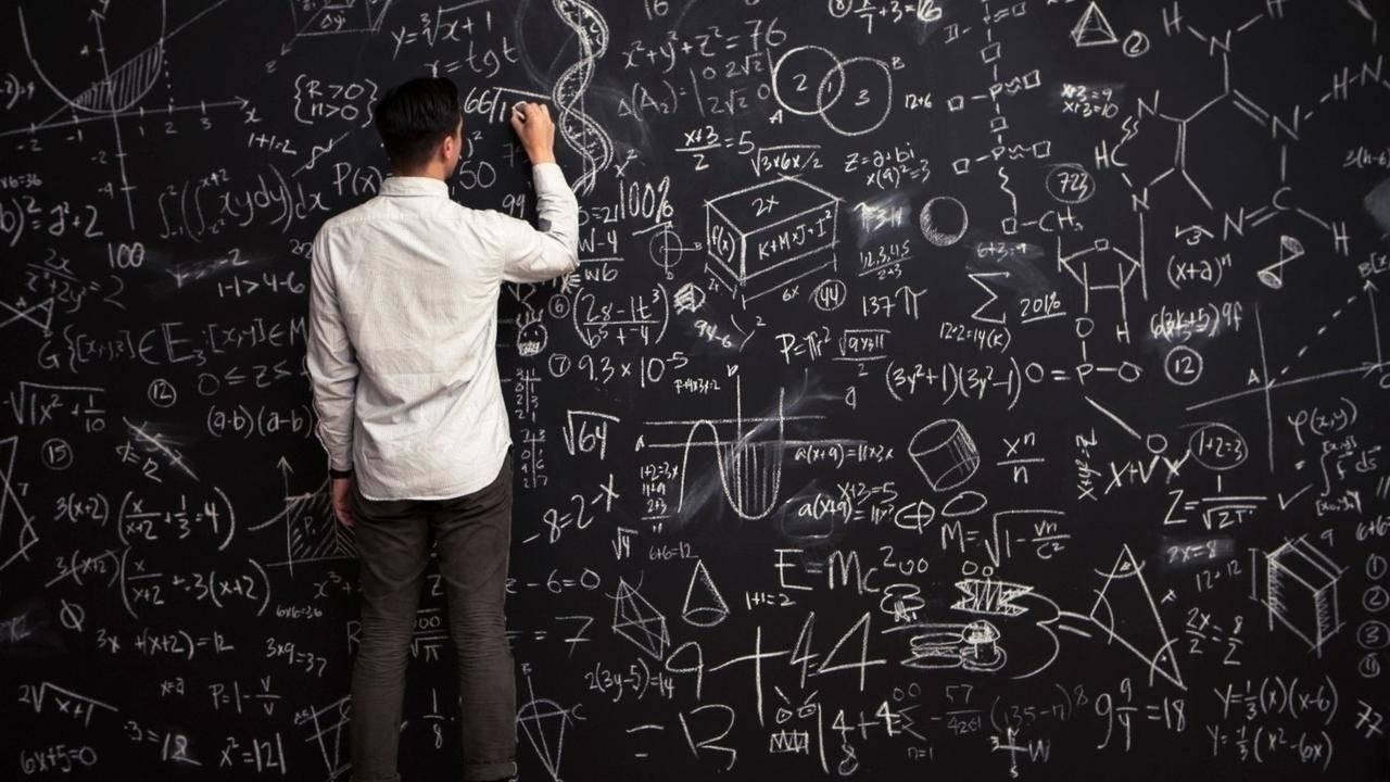 Man writing deductive logic on a whiteboard