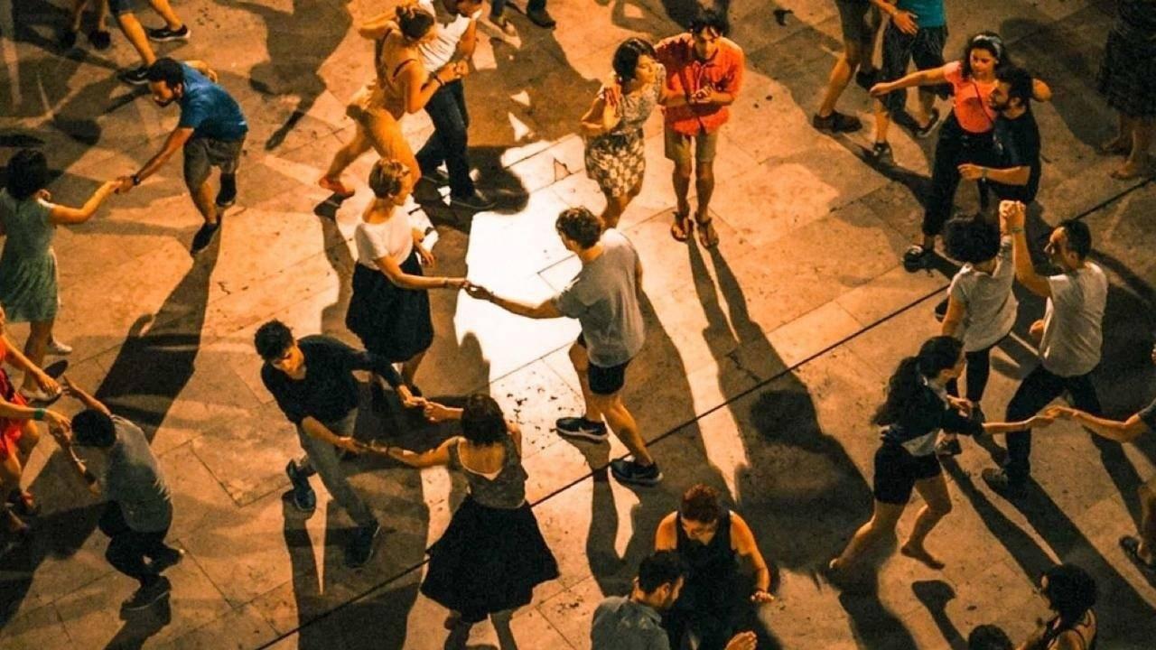 Team of people dancing outside