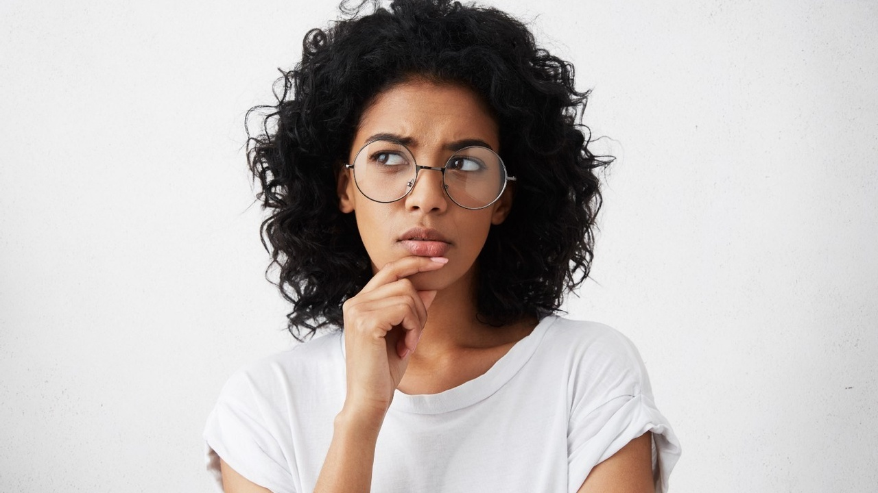 Women in glasses with puzzled look