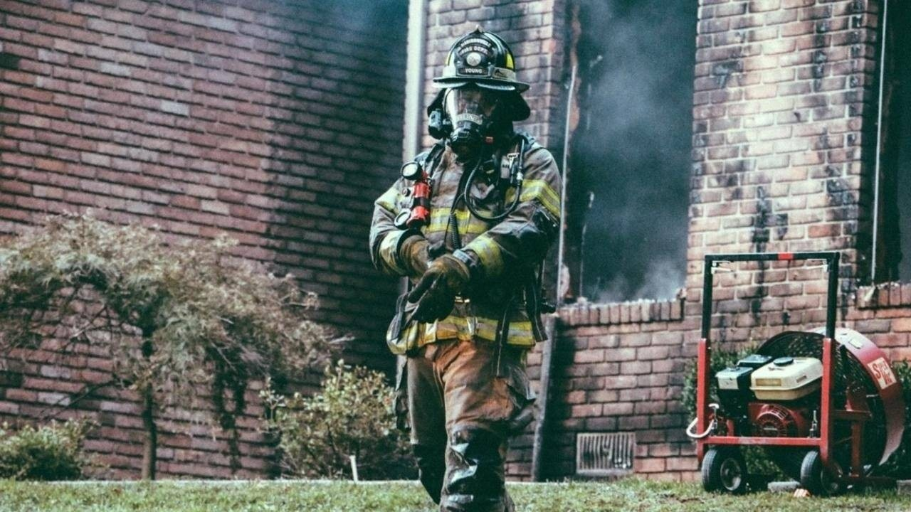 Firefighter reacting to fire