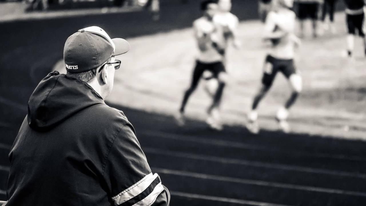 Coach watching their team