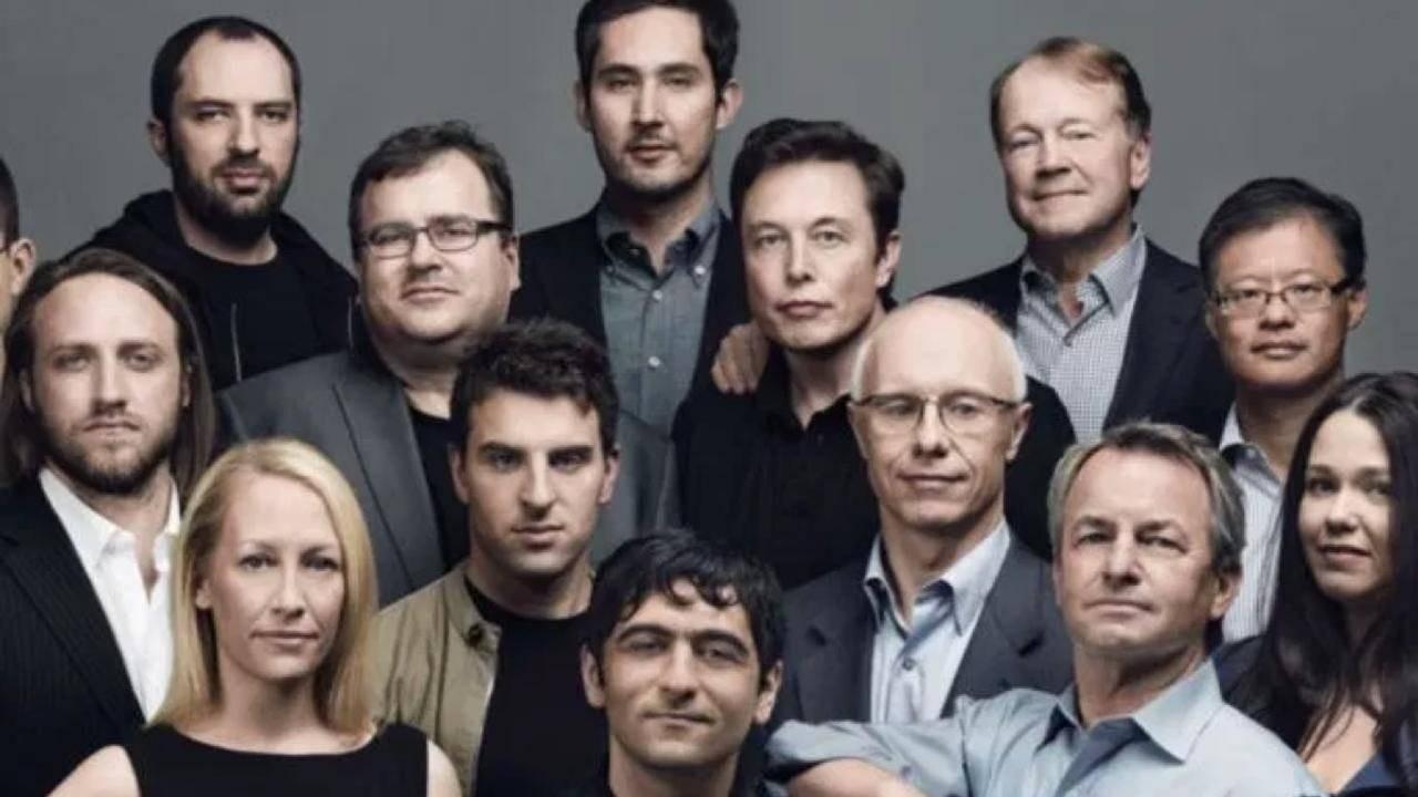 Elon Musk amongst a group of investors