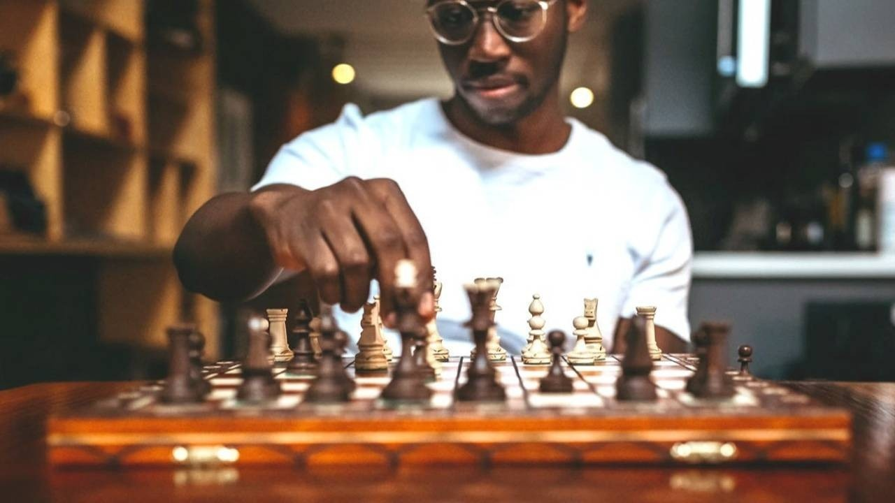 Man using strategy in chess game