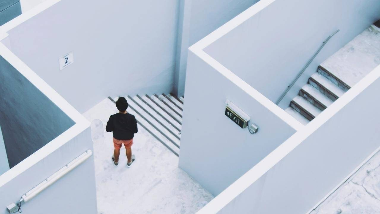 Startup CEO at the top of stairs