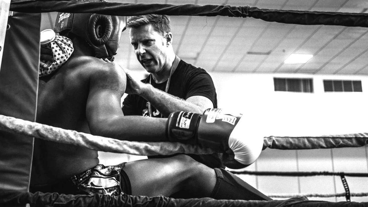 Coach motivating boxer in the ring