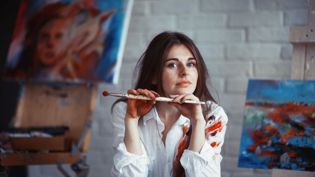 artist with paintbrush