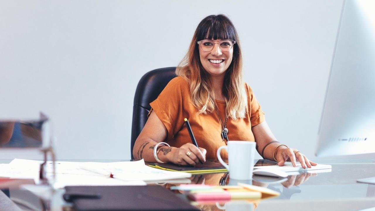 Woman at desk writing.