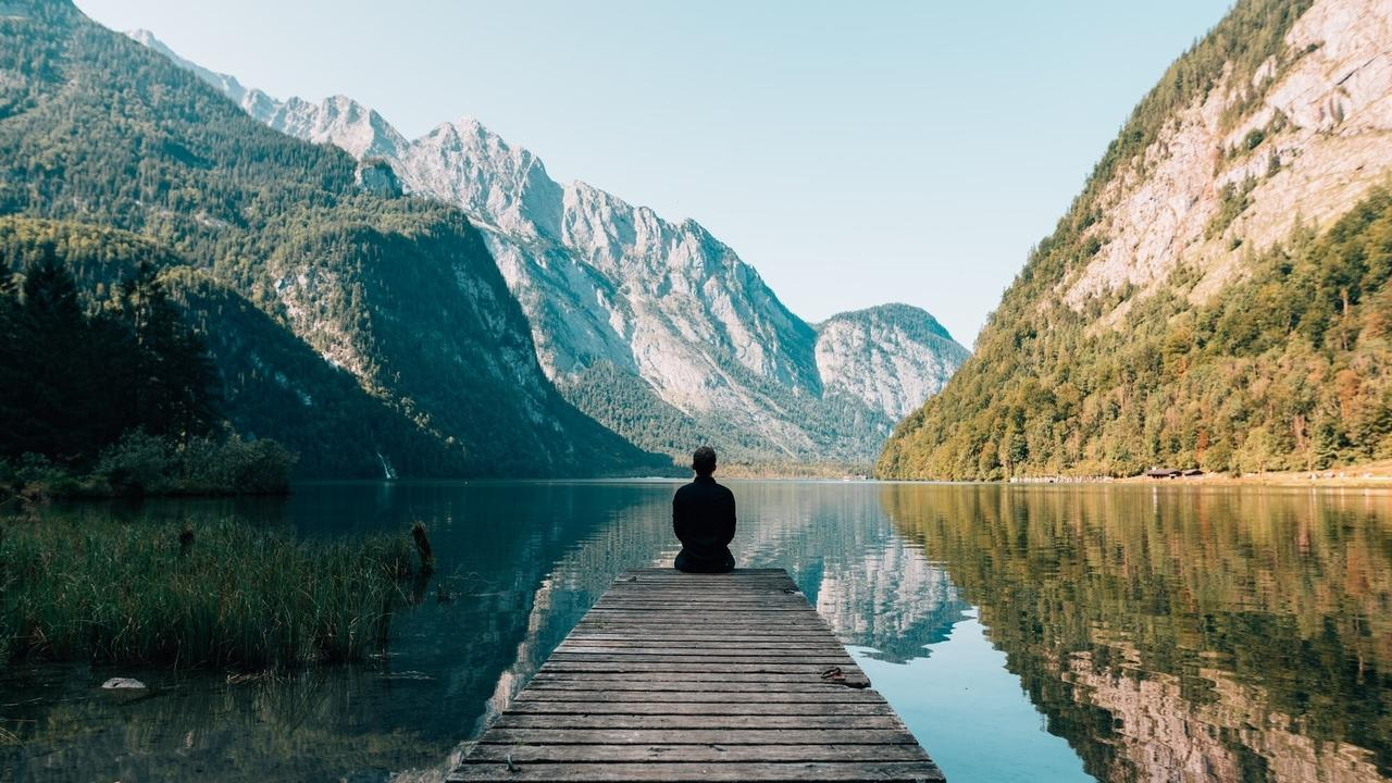 Man sitting on deck looking at beautiful scenery