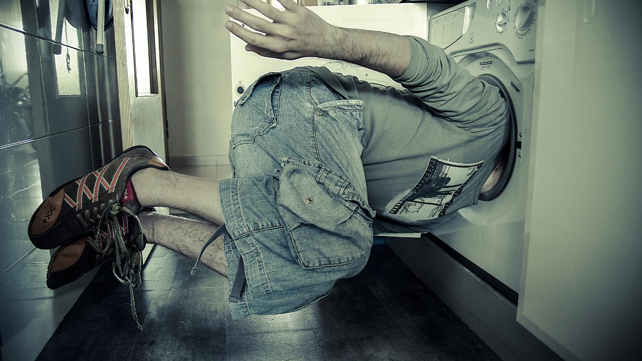 Men's head stuck in a dryer