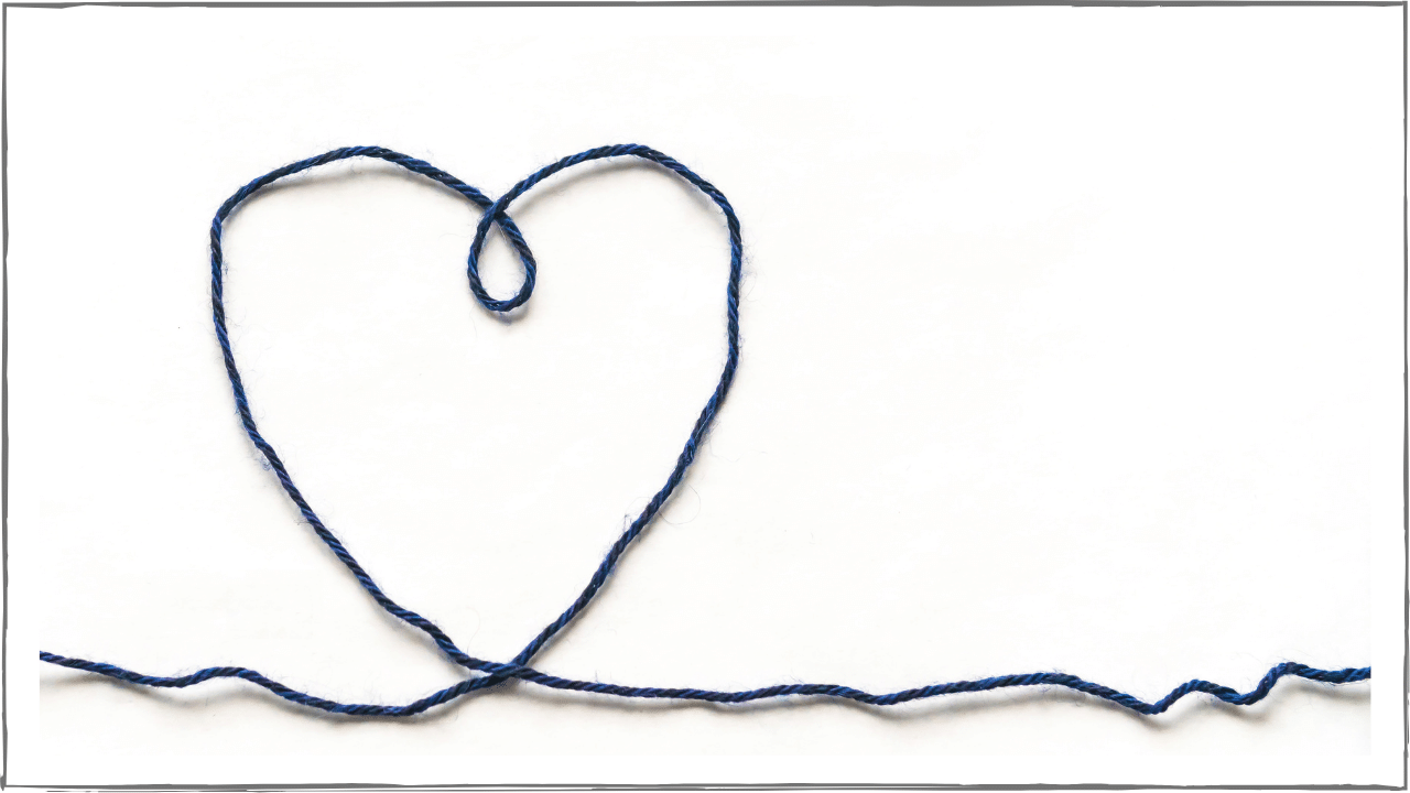 Piece of string moving along the bottom of the frame, stretching up into the shape of a heart.