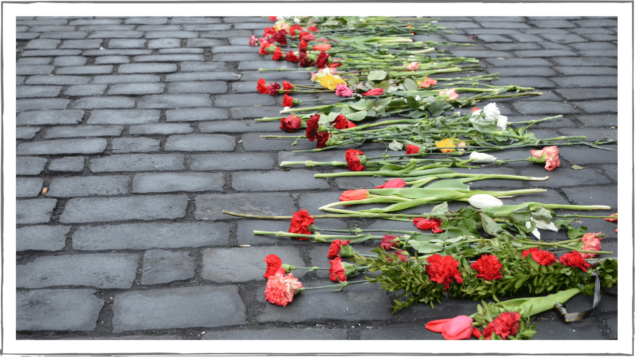 Cobblestone street with flowers laid out in a path
