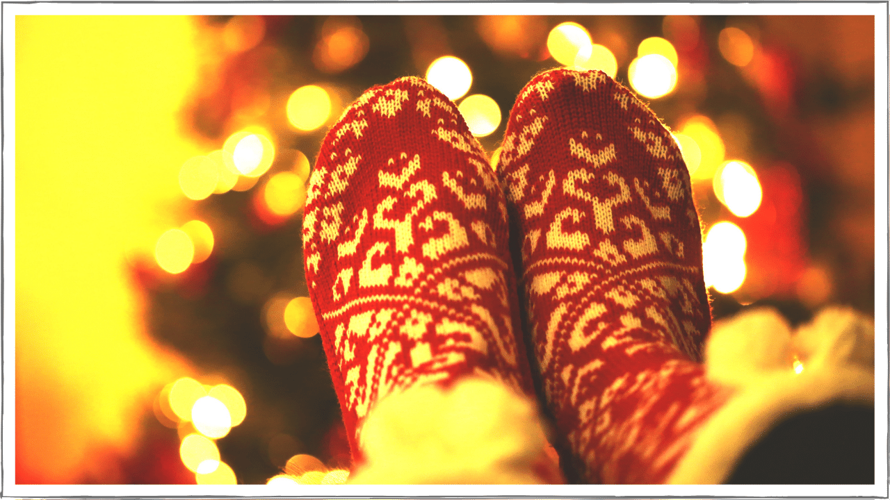 Cozy slippers in front of a bright fire or tree