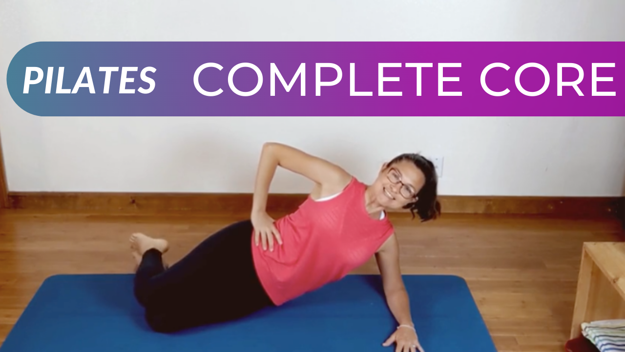 a picture of a woman in a Pilates exercise. She is on a mat doing a modified side plank on her elbow and knee. The name of the workout, Pilates Complete Core are written on the image.