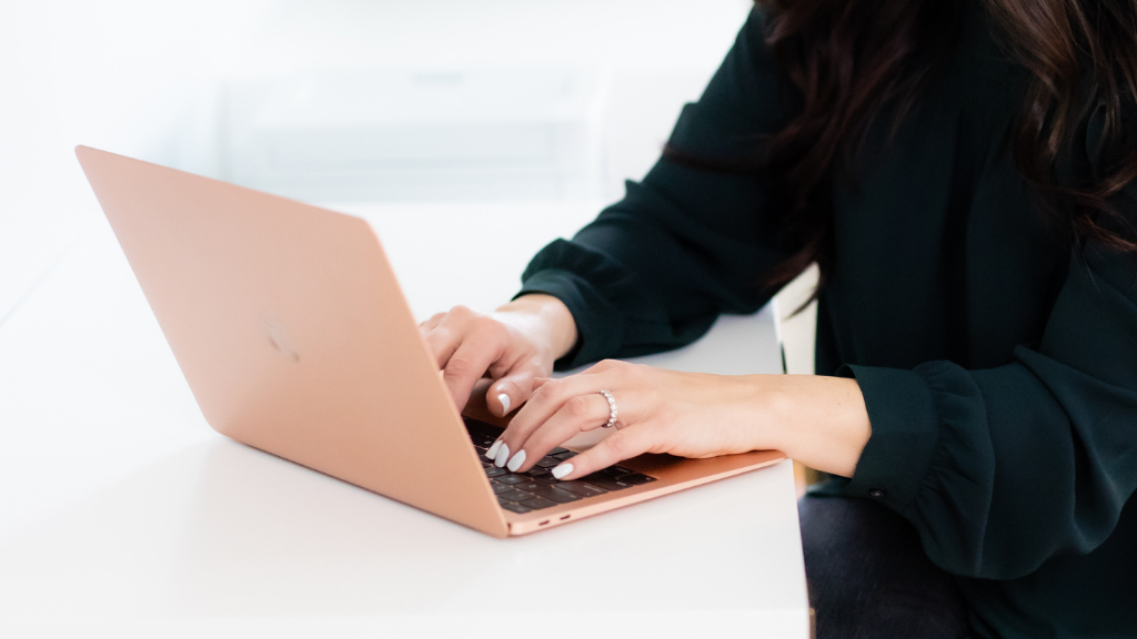 Photo of woman typing on a computer