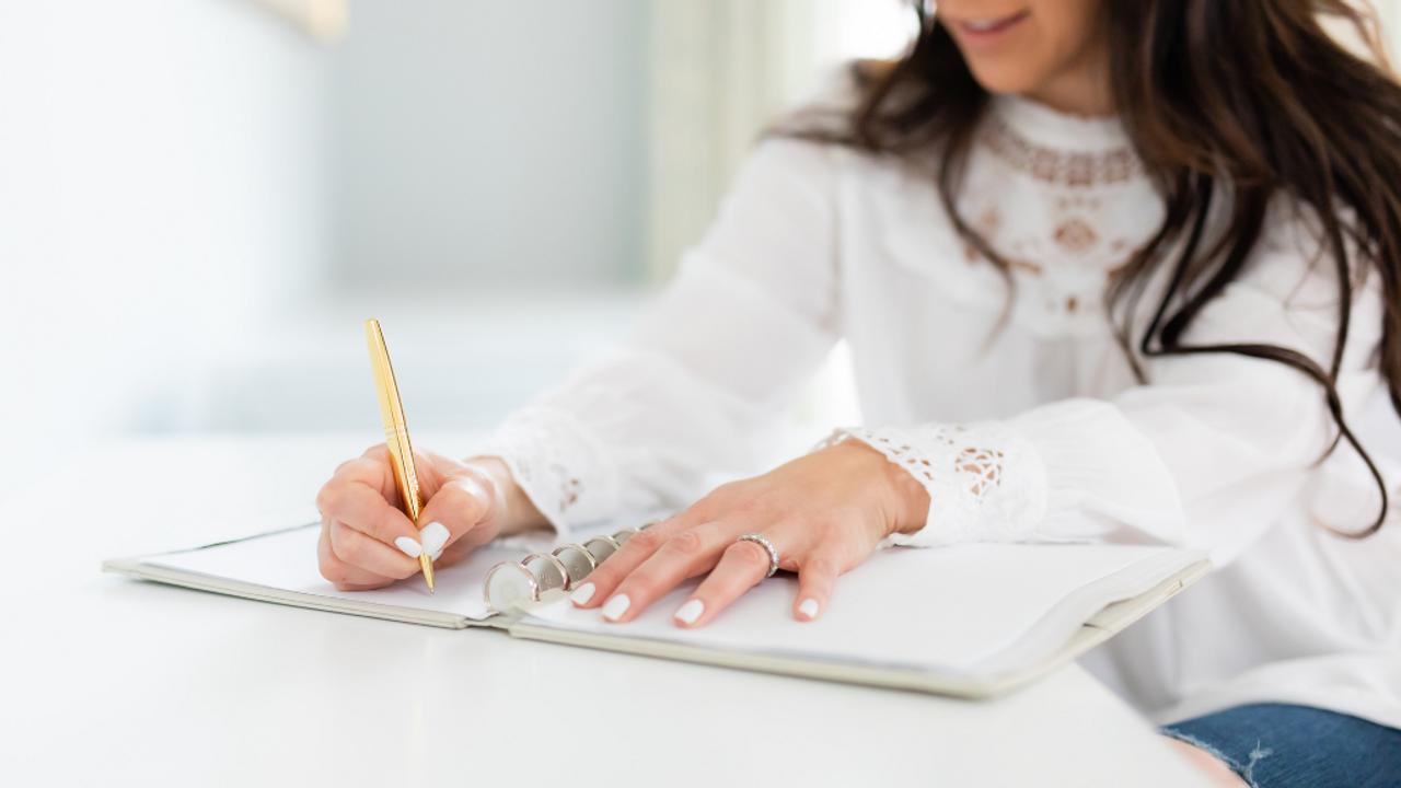 Woman working on side hustle