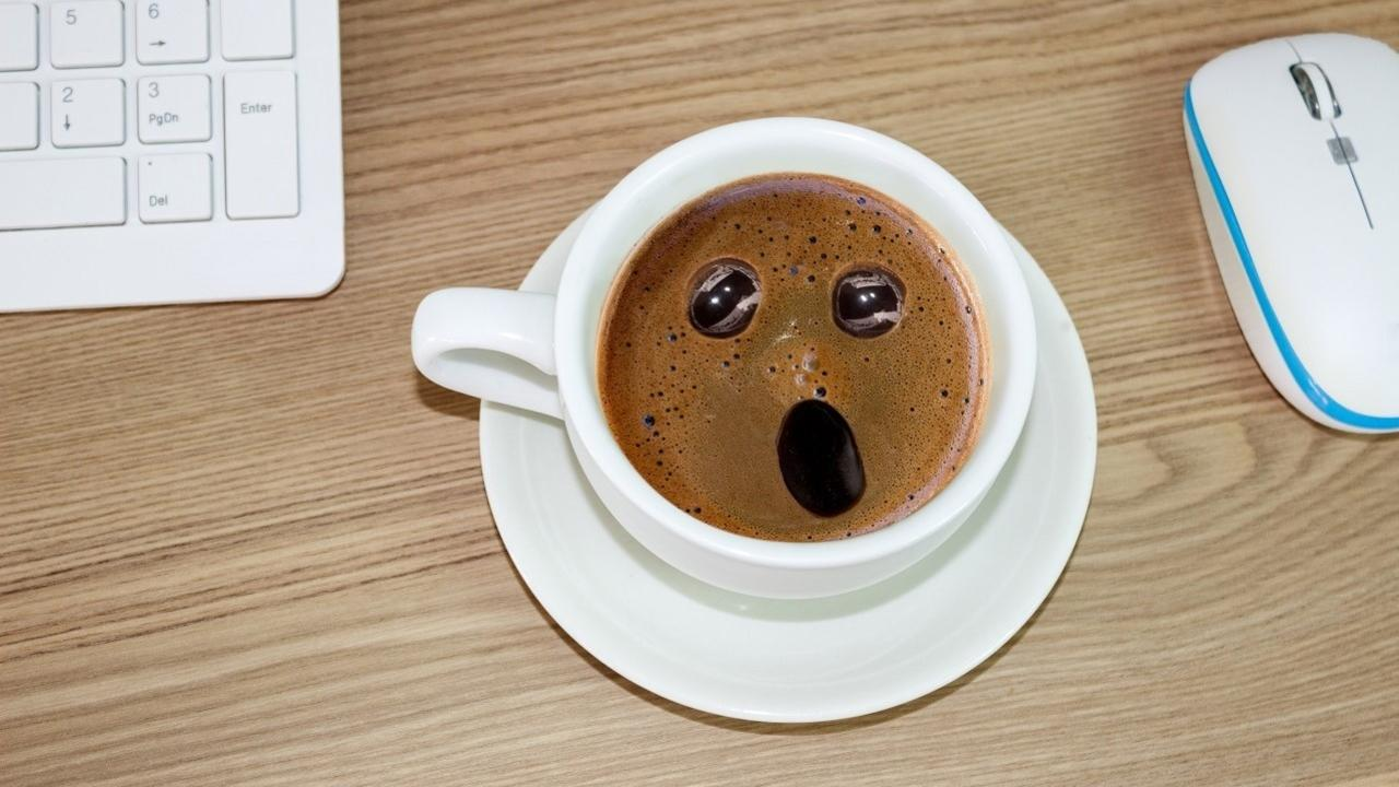 coffee cup showing shocked expression because of high caffeine