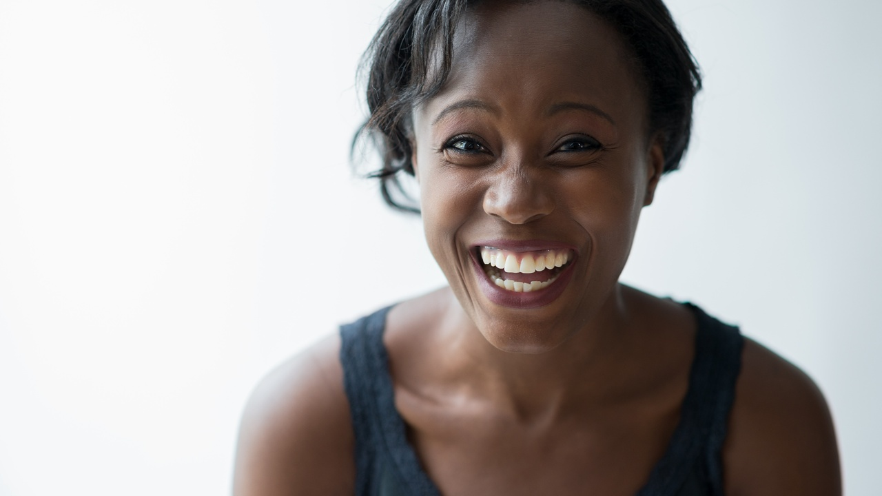 A woman smiling happily