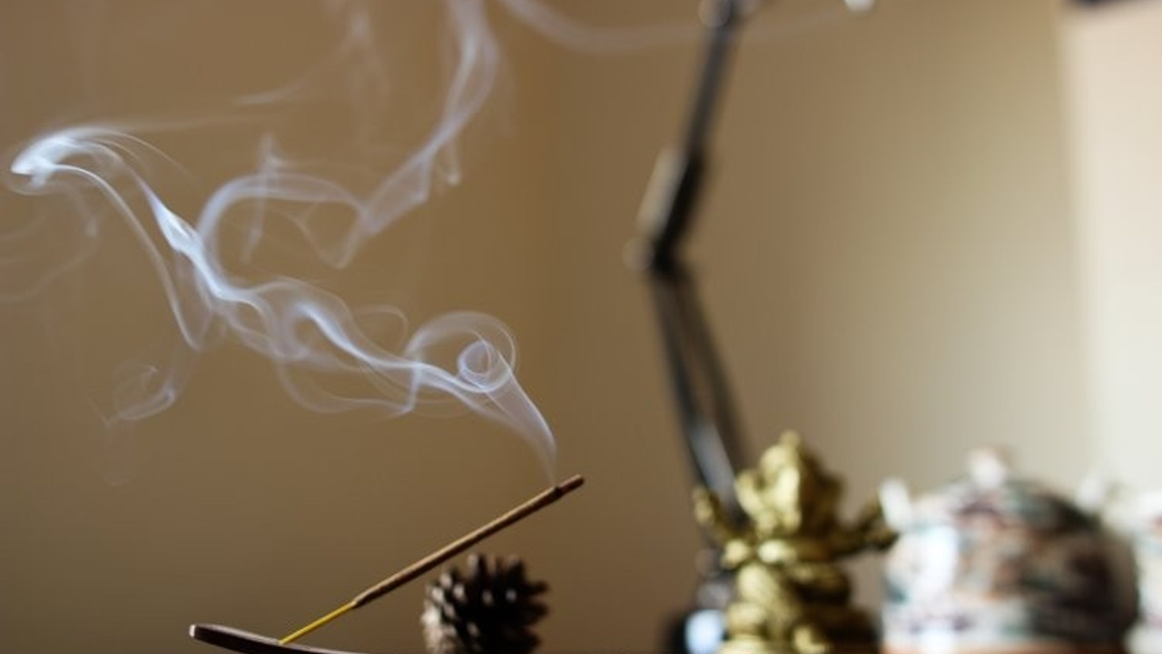 An incense stick scenting the room