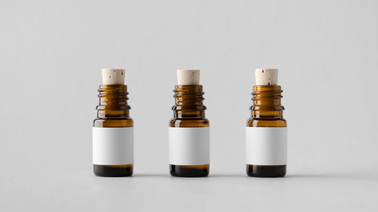 3 essential oil bottles with blank labels