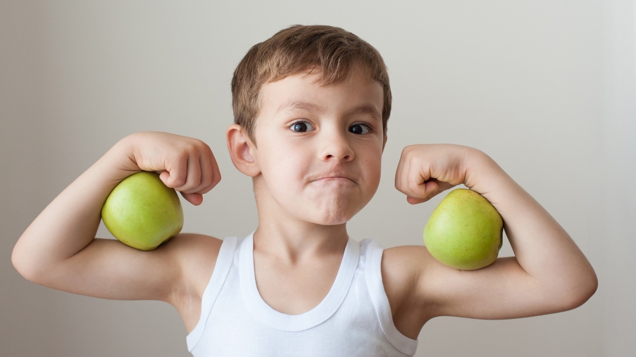 Healthy strong boy with apples