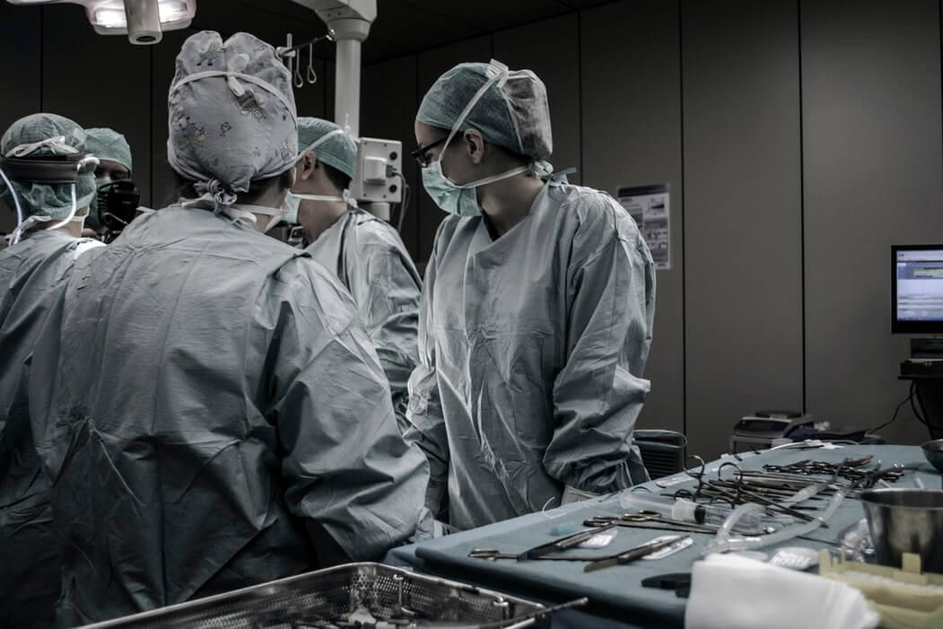 a group of surgeons at the operating table