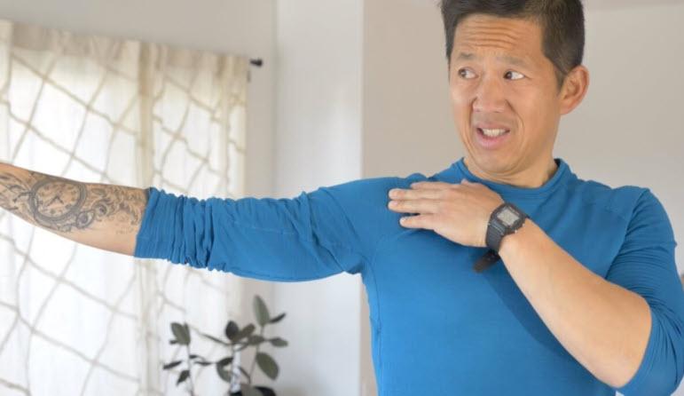 Matt Hsu, owner of Upright Health, demonstrates shoulder abduction.