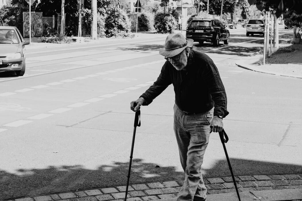 man walking with canes