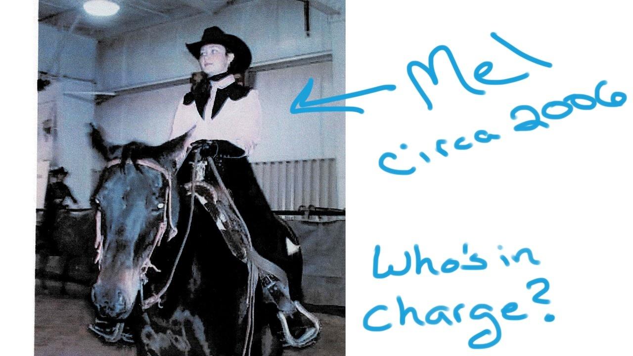 white woman riding a horse