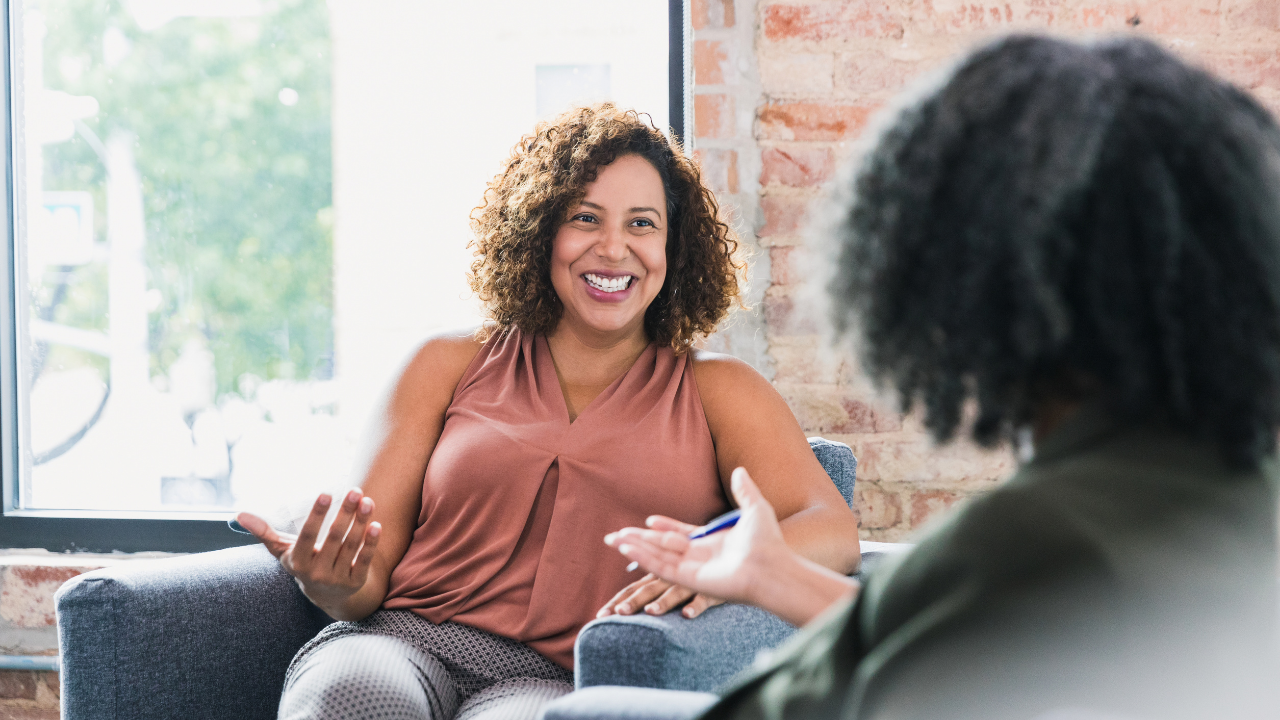 woman in therapy. Smiling woman with afro hair