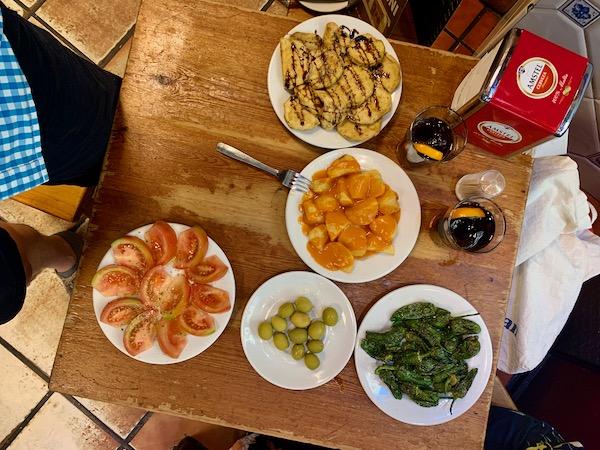 Tomato salad, fried eggplant, Padrón peppers, patatas bravas at Casa Toni