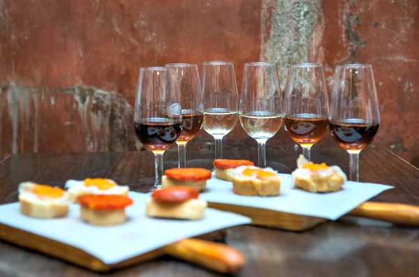 Sherry wines and open-faced tapas at Casa Morales, one of the best tapas bars in Seville.