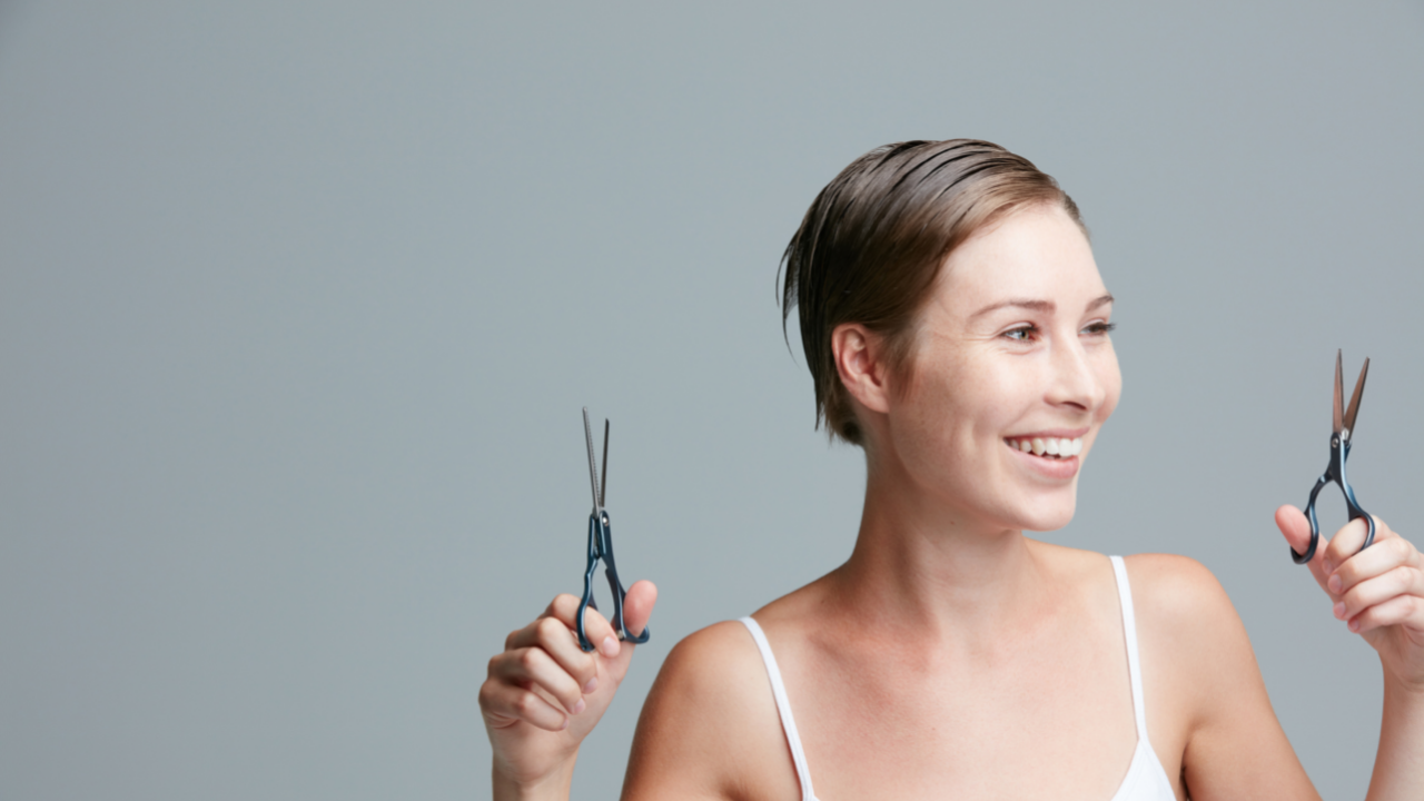 woman cutting her hair making a change