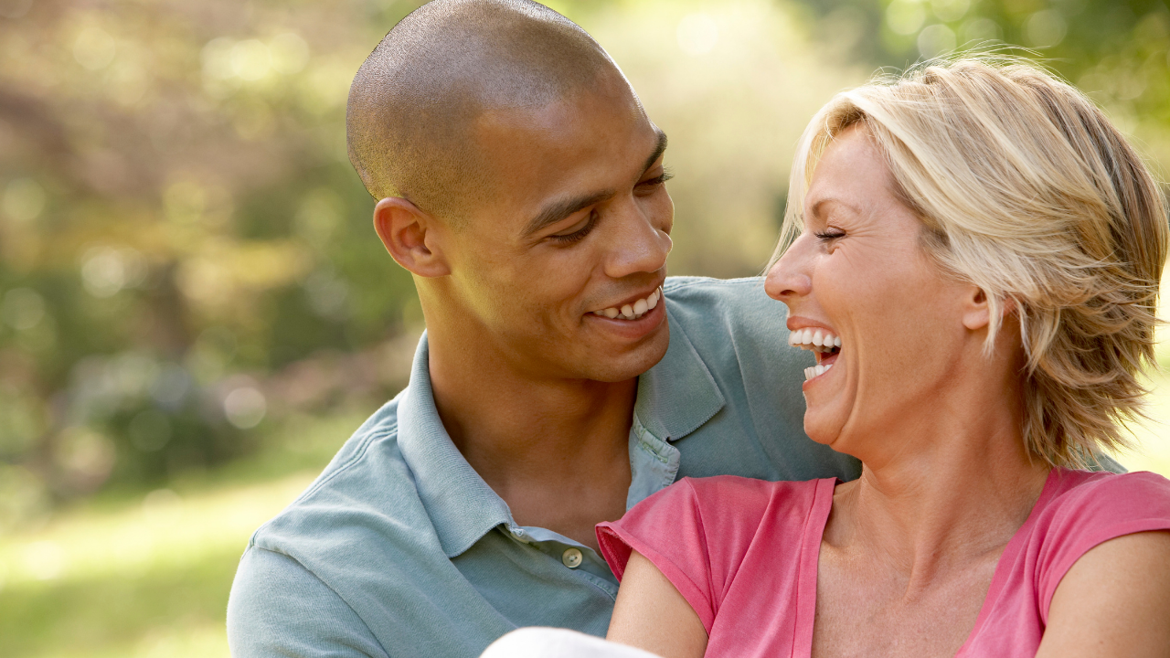 couple (man and woman) laughing and smiling