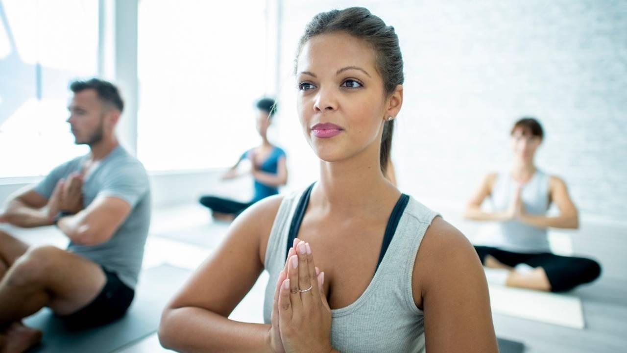 woman practicing yoga in yoga class