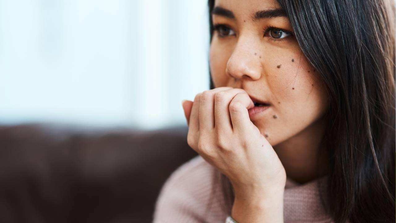 woman doubting herself biting nails