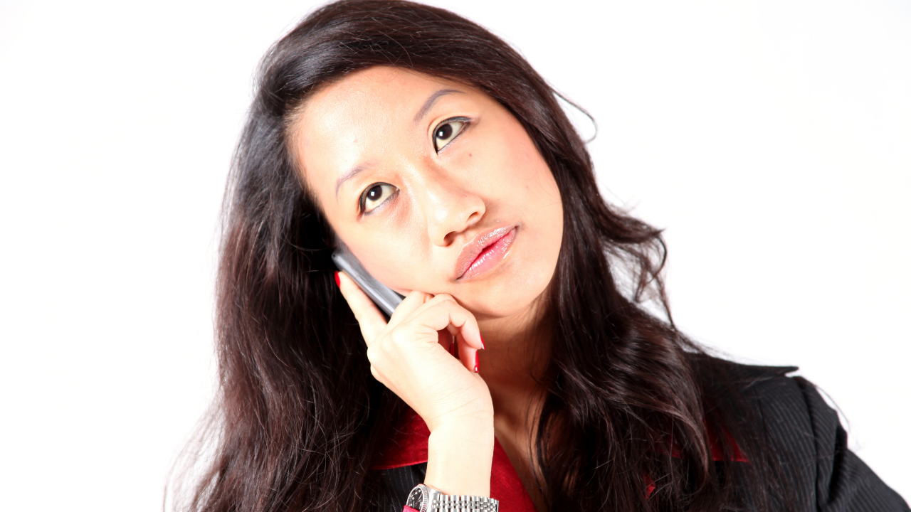woman waiting on hold on a phone call