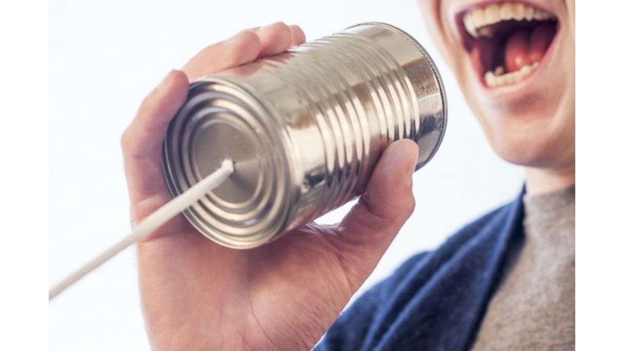 Person speaking to a can