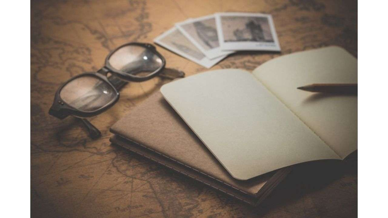Old notebook and glasses
