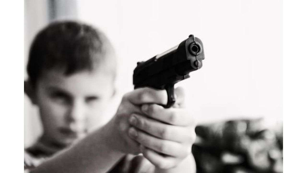 Child holding weapon