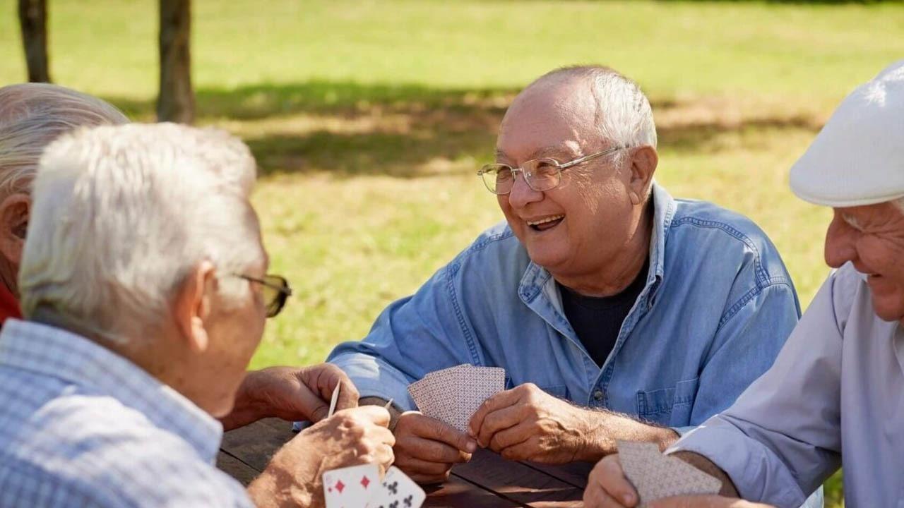 old men enjoying playing cards