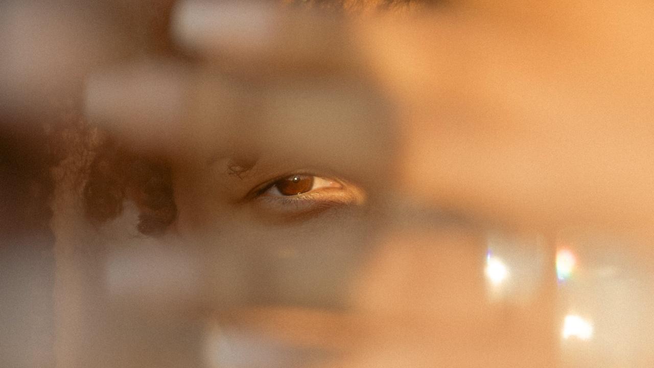 Eye peeping through hand
