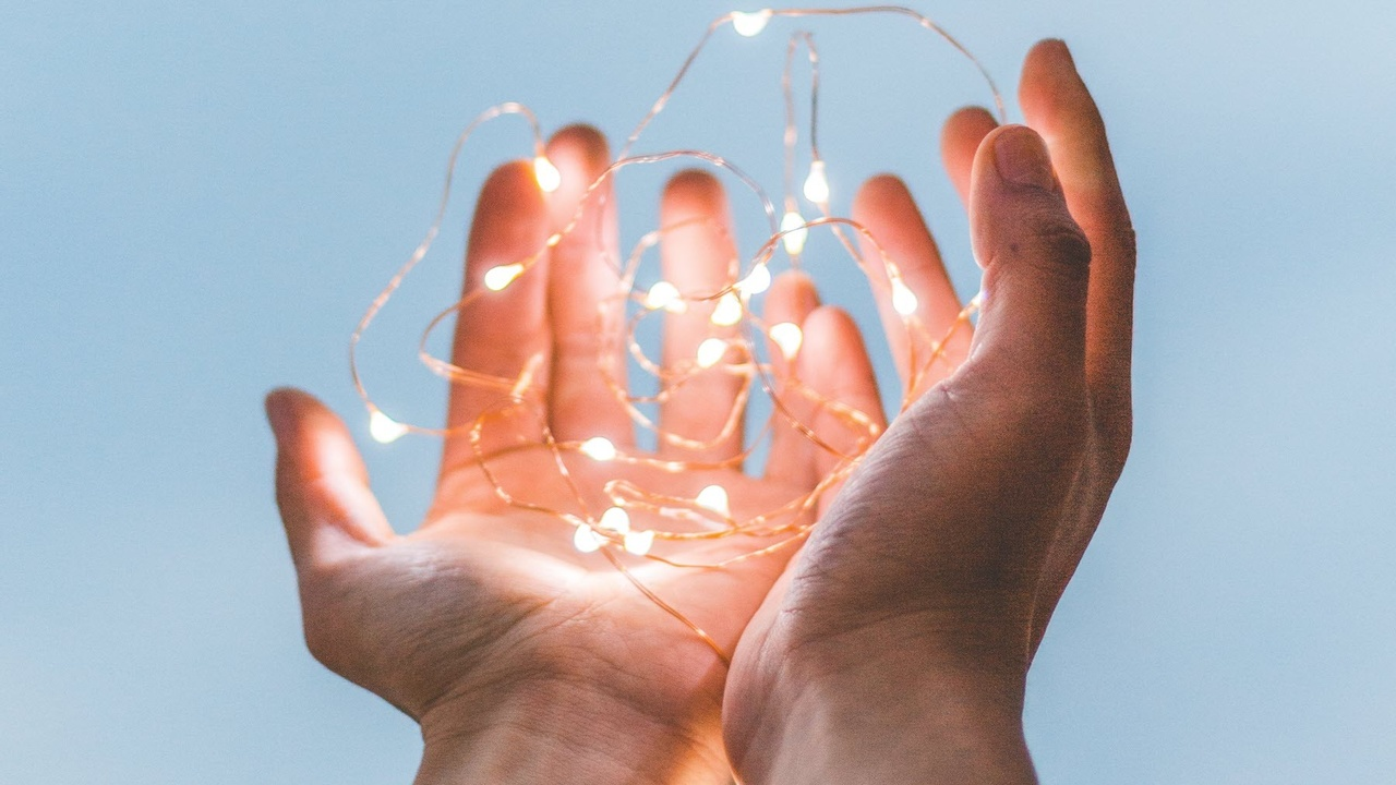 Hands with fairy lights