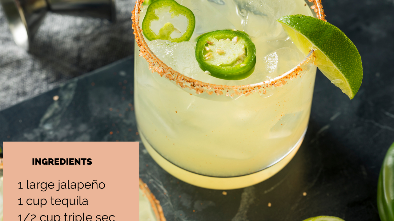 spicy margarita with ice in short glass garnished with spicy salted rim and fresh jalopeno