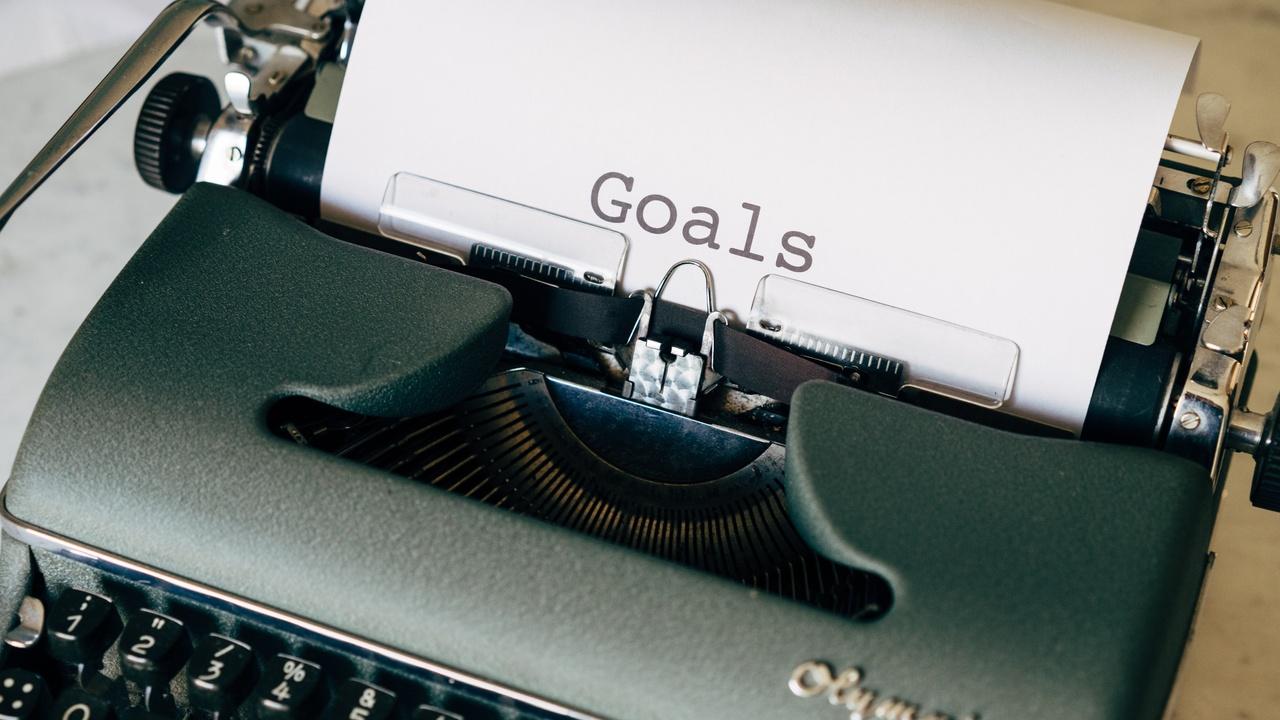 Typewriter typing the word, goals.